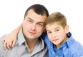 Father and son hugging her sitting on the floor studio photo on white background Royalty Free Stock Photo