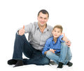 Father and son hugging her sitting on the floor studio photo on white background Stock Images