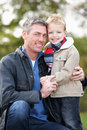 Father And Son Hugging On Outdoor Autumn Walk Royalty Free Stock Photos