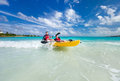 Father and son kayaking at tropical ocean Royalty Free Stock Images