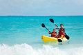 Father and son kayaking at tropical ocean Royalty Free Stock Image