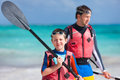 Father and son kayaking at tropical ocean Royalty Free Stock Photography