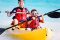 Father and son kayaking at tropical ocean Stock Image