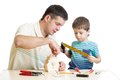 Father and son kid making wooden nesting box Royalty Free Stock Photo