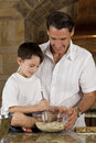 Father and Son In Kitchen Cooking Baking Cookies Royalty Free Stock Images