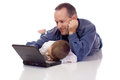 Father son laying their stomach laptop Royalty Free Stock Photo