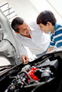 Father and son looking at car engine Stock Photos