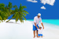 Father and son on maldives baby boy having perfect vacation standing with panama hats sunglasses white sandy beach with palm Royalty Free Stock Photo