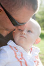 Father with son man his baby out for a walk on a sunny day in the park Royalty Free Stock Photography