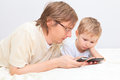 Father and son with mobile phones at home family communication Royalty Free Stock Image