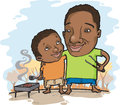 Father and son outdoors african american enjoying a barbecue in fall Stock Photos