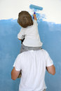 Father and son paint room Royalty Free Stock Image