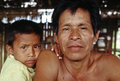 Father and son peruvian amazon a his in their hut in the Royalty Free Stock Photography