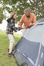 Father And Son Pitch A Tent Royalty Free Stock Photos