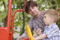 Father and son play on playground Stock Photography