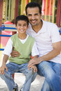 Father and son in playground Stock Images