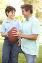 Father And Son Playing American Football Together Stock Image