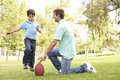 Father And Son Playing American Football Together Royalty Free Stock Photo