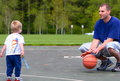 Father and son playing with ball Royalty Free Stock Photos