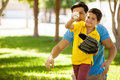 Father and son playing baseball cute boy his young outdoors at a park Royalty Free Stock Images