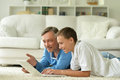 Father and son playing computer game Royalty Free Stock Photo