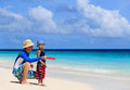 Father and son playing with flying disc at beach tropical Royalty Free Stock Photography