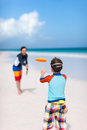 Father and son playing frisbee at beach Stock Photos