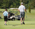 Father and Son Playing Golf Royalty Free Stock Photo