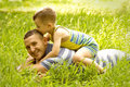 Father and son playing on green field Stock Photography