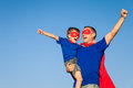 Father and son playing superhero at the day time. Royalty Free Stock Photo