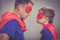 Father and son playing superhero outdoors at the day time. Royalty Free Stock Photo