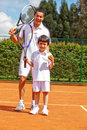 Father and son playing tennis Stock Images