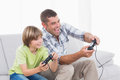 Father and son playing video game Royalty Free Stock Photo