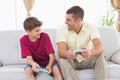 Father and son playing video game at home Royalty Free Stock Photo