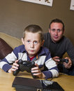 Father and son Playing Video Games Stock Photo
