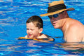 Father and son in pool Stock Images