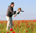 Father and son in poppy field Stock Photo