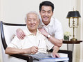 Father and son portrait of an asian senior his adult Royalty Free Stock Photography