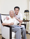Father and son portrait of an asian senior his adult Stock Image