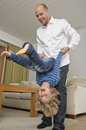 Father and son practice somersaults Royalty Free Stock Photo