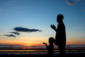 Father and son praying Royalty Free Stock Photo