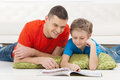 Father and son reading. Royalty Free Stock Photo