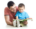Father and son reading together Royalty Free Stock Photo