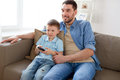 Father and son with remote watching tv at home Royalty Free Stock Photo