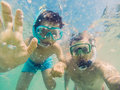 Father and son selfie vacation underwater Stock Photos