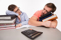 Father and son sleeping on books at the table Royalty Free Stock Photo