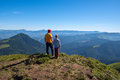 Father and son stand on peak and look into the distance Royalty Free Stock Photo