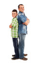 Father and son standing back to back Royalty Free Stock Photo