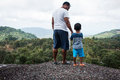 Father and son standing on  mountain Royalty Free Stock Photo