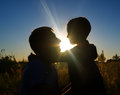 Father and son at sunset silhouette Royalty Free Stock Photography